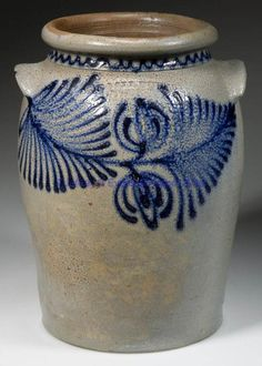"""VIRGINIA DECORATED STONEWARE JAR, salt-glazed, """"1 1/2"""" gallon capacity mark, semi-ovoid form with a single incised shoulder ring below the collared neck and rounded rim, arched tab-like handles. Bold slip-trailed cobalt double tulip blooms flanked by elaborate fern-like leaves on front, matching horizontal tulips on reverse, additional cobalt sine-wave surrounding the collar. Benedict Calvert Milburn (1805-1867), Wilkes Street pottery, Alexandria, VA. Circa 1847-1861. 10 3/4"""" H, 6"""" D rim…"""
