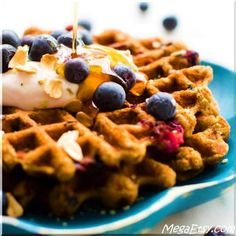 Naturally gluten-free waffles made with oats and flecked with sweet berry spots– these are a perfect easy, healthy breakfast!