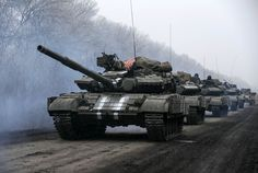Ukrainian servicemen ride on a tank near Debaltseve, eastern Ukraine