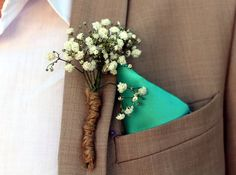 For your rustic themed wedding, a little sprig of baby's breath is the perfect choice for comprising your groom and his groomsmen's boutonnieres. Don't you agree?  https://www.ravenluxuryevents.com/  #boutonniere #ravenluxuryevents #weddingflower #wedding  Photo Source: https://pixabay.com/en/arrangement-flowers-groom-lapel-1375783/