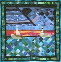 "Sunset at the Water's Edge Lap Quilt 07  ""This quilt is a joint effort by several ladies at the LCSO. It brings to mind watching the sunset from the beach or the edge of the water, and what you would see as you look out onto the water.  The abstract-diagonal-quilting pattern reflects the moon rising over waves and the sun setting."""