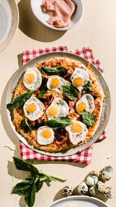 Roll out of bed and wish really hard that someone special will bring you this brunch-y pizza topped off with melty mozzarella, ham, and mini sunny side up quail eggs.