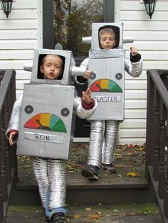 Homemade Halloween Robot Costumes - made from boxes, plastic cups and flexible dryer vent hose, silver duct tape, silver spray paint