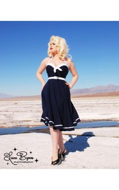 Our newest design for Spring is this whimsical nauticalinspired swing dress. Featuring a vintage inspired structured bustline (to lift and enhance!), fitted bodice, and a full swing skirt, with contrast sailor trim at the hem and bustline. Made from the highest quality stretch bengaline, and featuring the impeccable construction and fit that's made us famous. See more at: http://www.pinupgirlclothing.com/pinup-couture-sailor-swing-dress.html#sthash.xSGF7dxF.dpuf