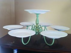 Brilliant idea! Use and old chandelier to make a multi tier cake stand. I can see it loaded up with pretty cupcakes! I love it!!