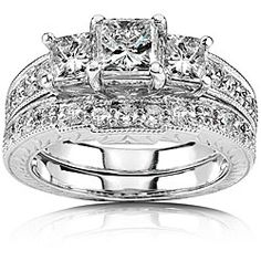 @Overstock - Click here for Ring Sizing ChartWedding ring is crafted of 14-karat white goldRing features 1 5/8* carats TDWhttp://www.overstock.com/Jewelry-Watches/14k-White-Gold-1-5-8-ct-TDW-Diamond-Wedding-Ring-HI-I1-I2/2678865/product.html?CID=214117 $2,199.99