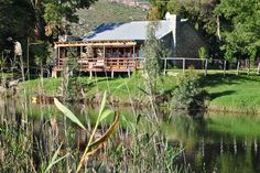 At River Edge you are surrounded by mountains that turn pink at sunset, vineyards stretching into the horizon, fynbos alive with small wildlife, and Best Weekend Getaways, River House, Open Plan Kitchen, Cape Town, Gazebo, Places To Go, Cottage, Outdoor Structures, House Styles
