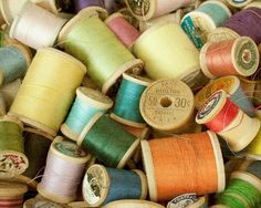 I love collecting old spools of thread at estate sales and the like. This is not my picture, but I do have some old wooden spools like these. I think I need to put them in a jar for display...