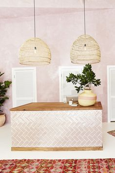 Dusty pink, lime-wash rendered walls, a matching chevron hand-tiled counter, an array of earthy tones, and an enviable collection of indoor plants at Mister Zimi