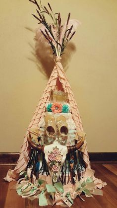Boho Themed Teepee Diaper Cake with Feather Infant Crown, Fringe Sandals, Ceramic Skull and more.