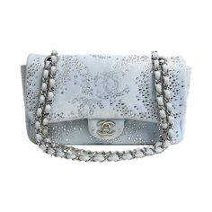 Chanel Blue Swarovski Crystal Classic Flap Bag   From a collection of rare vintage shoulder bags at https://www.1stdibs.com/fashion/handbags-purses-bags/shoulder-bags/
