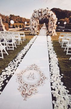 Aisle runner with rose petals and a floral pergola. ~Spring Wedding~ {Decor}