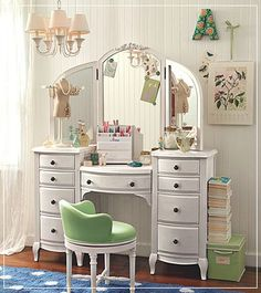 White Vanity. Love the tri-fold mirror and the drawers for storage. The lines are beautiful.