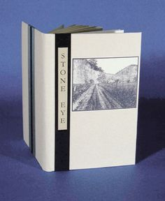 Stone Eye by Julia Miller. Twinrocker abaca case binding w/ cloth inlays, made endbands, & inkjet title. Cover photo & 5 photo inserts in text. Images from KY created from original color & B photos, printed on Mohawk Superfine w/ inkjet printer & archival inks. Photography by Wayne Jones. Richard Taylor, KY's former poet laureate, & Gray Zeitz, letterpress printer & publisher of Larkspur Press, produced the collection of poetry, Stone Eye. Canadian artist Wesley Bates cut the wood…