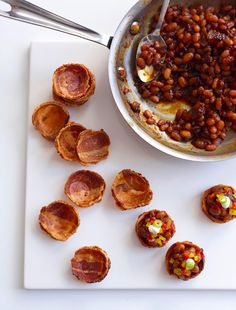 Bacon cups!  No how-to on this site.  I'm guessing, just put them in a mini muffin tin and bake.  Then fill with yummy things for a great appetizer!