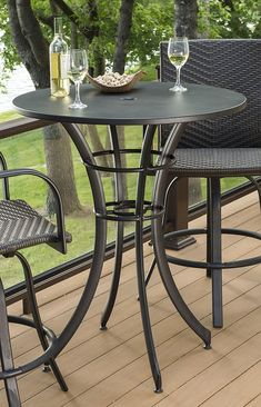 Maximize space on your deck with this round pub table and tall chairs.| outdoorrooms.com