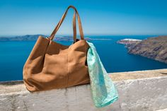 Our massive natural greek leather bag Ursa Major. Find it here: http://www.thewhitesantorini.com/e-shop/accessories-15/leather-bags/ursa-major-leather-bag/  Embroidered linen pareo Oceanis. Find it here: http://www.thewhitesantorini.com/e-shop/accessories-15/scarves-and-wraps/oceanis/