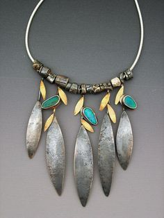 "The Southwestern motif comes across dramatically in all of McLeery's work.  Her gorgeous ""Leaf"" necklace has small 22K gold leaves and opals, separated by handmade silver textured beads."