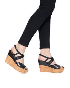 wedges!! They might be pushing it. But is you look closely they are almost flat on the foot bed.