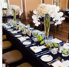 Nautical Themed Weddings Centerpieces | Tall vases of hydrangeas and orchids topped the long head table.