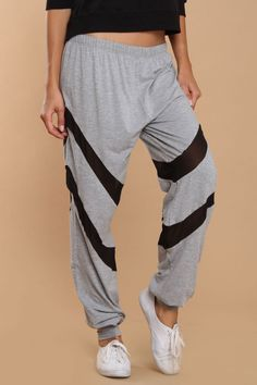 how your strips in these fun and casual pants  Features elasticized waist  Inset panel detail  Stretch detail at ankles