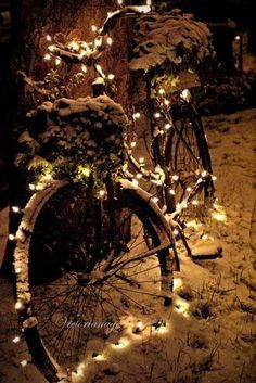 Christmas - bicycle with lights in the snow.
