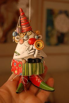 My Mum used to collect bells.  How I'd have loved to have given her this one!  Isn't he gorgeous!?  Clown Bell by natalyasots on Etsy, $95.00