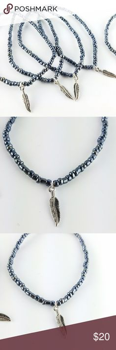"Hematite Beaded Feather Charm Anklets Genuine Hematite seed beads with a silver plated feather charm. Strung on thick stretch cord for durability. Measures 10"" in length.   Listing is for individual anklets.   Magen's Fairytale Creations original handmade by me. Magen's Fairytale Creations Jewelry"