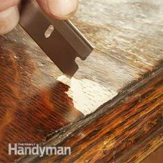 First, smooth and shape the epoxy with a wet finger. Then use the edge of a straightedge razor to scrape the surface almost level with the surrounding veneer. If you're repairing wood with an open grain, like oak, add grain details by making little slices with a razor while the epoxy is soft.