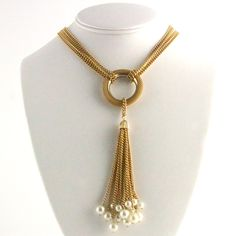 "Four strand gold chain with gold hoop and fifteen pearl tassel pendant. Length 14"". www.ballandchainvintage.com"