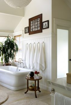 Content in a Cottage- This looks like a great family bath, doesn't it? The children must be small and not in charge of hanging up their own big white towels. Bath time here would be fun in this wonderful tub!