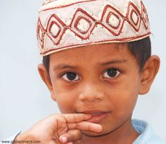 Big-eyed Muslim boy in the streets of Chennai (Madras), state of Tamil Nadu, INDIA