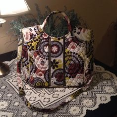 Brand new never used VERA BRADLEY tote bag. Super sure brand new VERA BRADLEY TOTE BAG WITH STRAP.  Looks of side pockets to hold treasures  Vera Bradley Bags Totes
