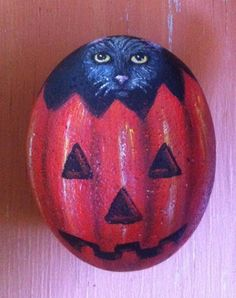 Black Cat in Jack O Lantern Pumpkin on A Hand Painted Rock Halloween Painting
