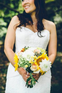 Yellow, wildflower bouquet from Michelle & AJ's intimate, summer wedding in Northern Virginia. Images via Michael Munoz Photography.