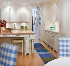 A hallway leads from the front door to the back of the house, passing through the kitchen and into the breakfast room. Counter seating and a large table allow the family to gather when preparing meals.