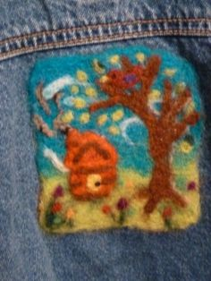 This design was needle felted onto the back of a upcycled 2T jean jacket.