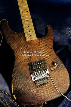 Happy Birthday to one cool dude. NO ONE else has an original guitar like your's wrapped in Python skin!  Warren DeMartini