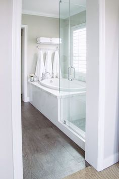 Neutral Bathroom- Great look to have glass surround instead of 1/2 wall in between tub and shower