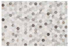 Handmade by artisans in India, this luxurious rug boasts a modern geometric motif. Crafted from natural cowhide for an elegant appeal, this piece will bring a light and airy style to any space. A...