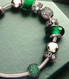 Sneak-peek at the Fall-Winter collection. The owl looks interesting, and there's that green faceted murano.