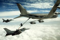 A U.S. Air Force F-16C Fighting Falcon fighter aircraft from the 401st Tactical Fighter Wing refuels from a U.S. Air Force KC-135 Stratotanker as another F-16 waits in formation during Operation Desert Storm.