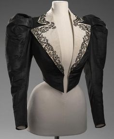 Outfit  1892  Artist/s name REDFERN (couture house) John REDFERN (designer)   Medium silk, glass, chiffon, jet Measurements (a) 160.0 cm (centre back) 60.0cm (sleeve length) (jacket) (b) (centre back) (waist, flat) (bodice) (c) (centre back) (waist, flat) (skirt) Place/s of Execution London, England Accession Number D187.a-c-1974 Credit Line National Gallery of Victoria, Melbourne The Schofield Collection.