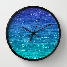 Sea sparkle wall clock by Catspaws on Society6