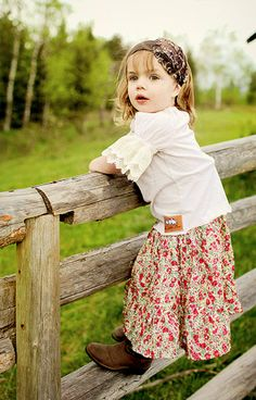 I love her skirt and blouse and boots and homeschooled, farm-kid cuteness.