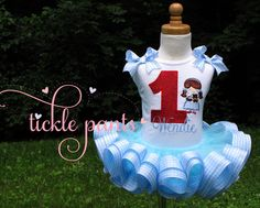 Wizard of Oz Dorothy Birthday Tutu Outfit- Baby blue and sparkling red- Includes top, ruffled tutu - Can be made to match your party by TicklePants on Etsy https://www.etsy.com/listing/195198417/wizard-of-oz-dorothy-birthday-tutu
