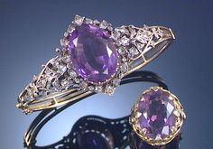 AN AMETHYST AND DIAMOND HINGED BANGLE AND AN AMETHYST RING 1870S. The central cluster set with an oval amethyst within surrounds and between shoulders of foliate design set with rose-cut diamonds, circumference approximately 170mm, accompanied by a ring set at the centre with an oval amethyst within a bezel of foliate detail,