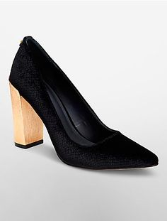 a pump designed with textured suede, a striking textured gold block heel and…