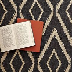 West Elm | Handwoven diamonds add modern-primitive panache to the floor or when casually strewn over furniture.