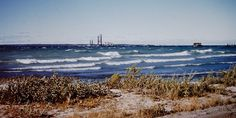 Early Mackinac Bridge construction and Great Lakes freighter